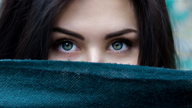 Black Haired Girl with Green eyes